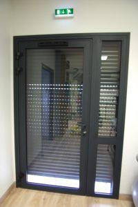 Porte en aluminium et volet électrique